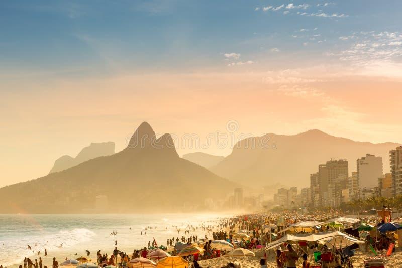 People sunbathe on Ipanema beach royalty free stock image