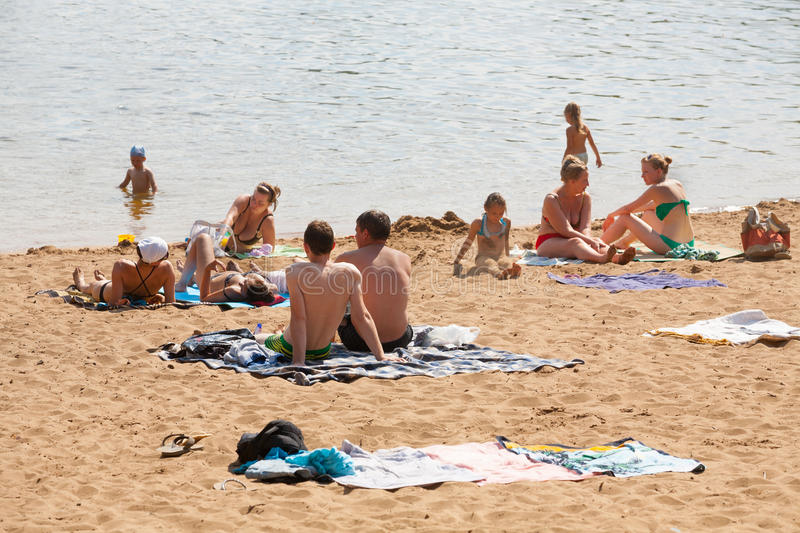 People sunbathing on the beach stock photography