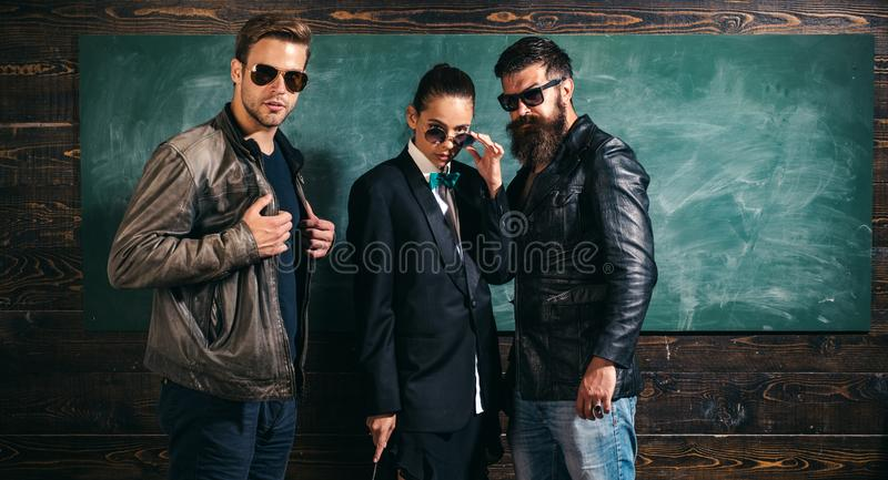 People in sunglasses. Woman and men wear masculine clothes and eyeglasses. Girl formal jacket suit and guys sunglasses stock images