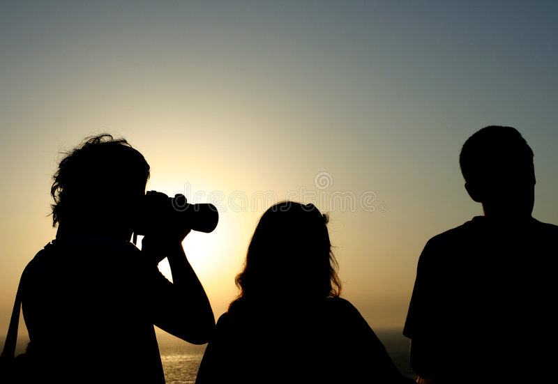 People in the sunset royalty free stock photos