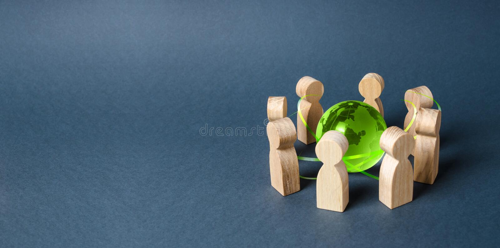 People surrounded a green Globe world planet earth. Diplomacy and crowdfunding. Concept of cooperation and collaboration of people. And countries around the royalty free stock image