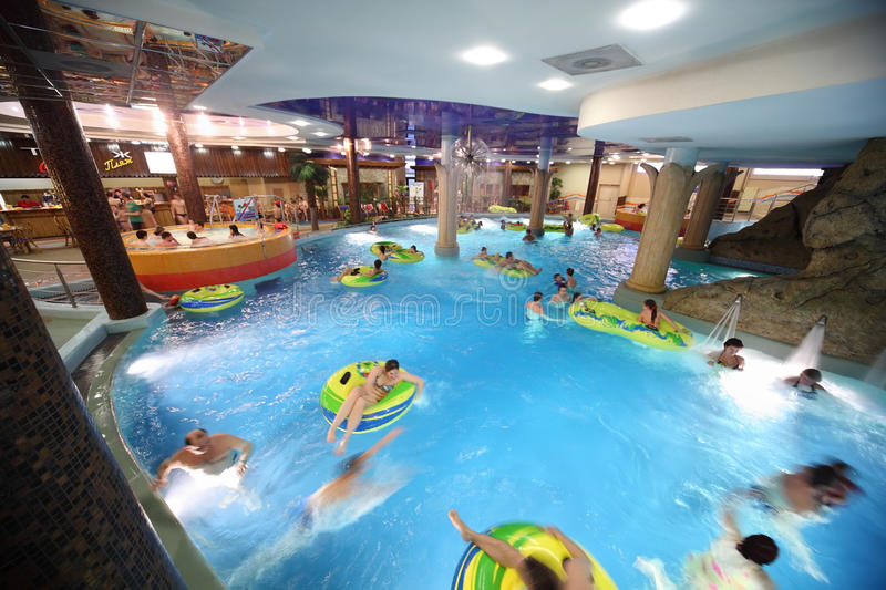 People swim on inflatable circles in pool royalty free stock photography