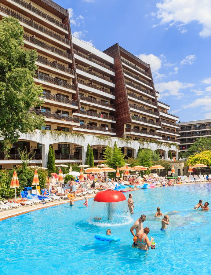 People swim in pool of hotel Flamingo Grand Hotel at summer sunny day stock image