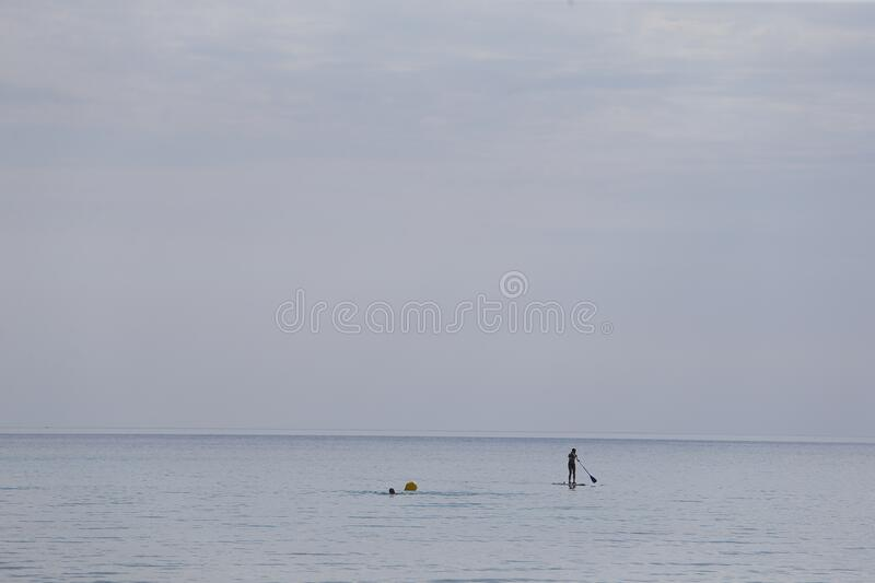 People swim or practice sports in El Arenal Beach royalty free stock photo