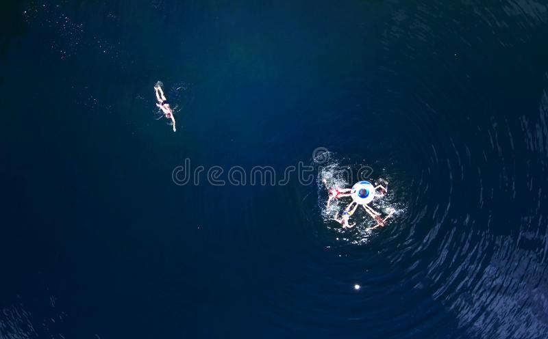 People swim in the river have a good time, photo from drones, summer holidays. People swim in the river have a good time, photo from drones, summer stock image