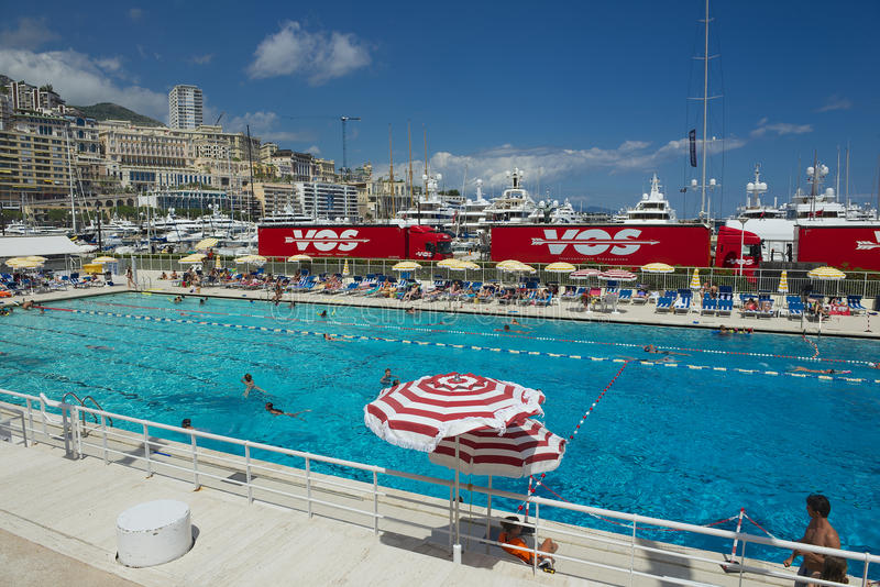 Download People Swim And Sunbathe At The Open Air Public Swimming Pool In Monaco Editorial
