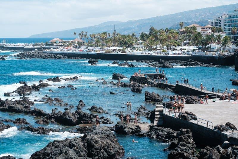 People swimming in ocean pools at coast of   Puerto de la Cruz, Tenerife stock photos