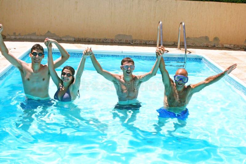 People in swimming pool stock image