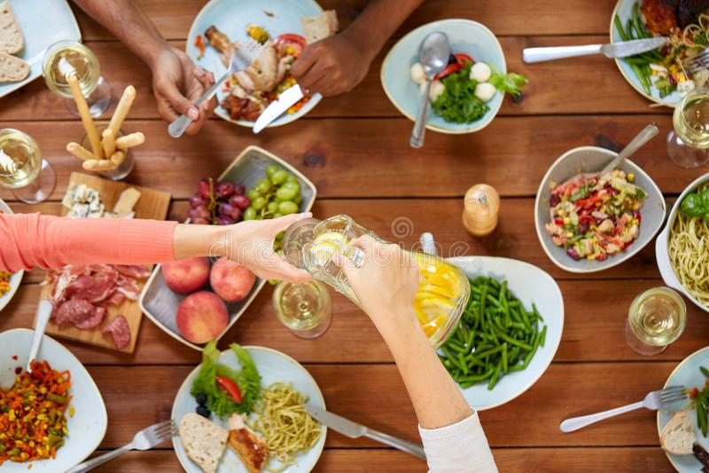 People at table with food eating and drinking royalty free stock photos