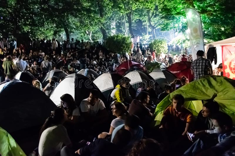 People take part in massive anti-government protest at night in Gezi Park in Taksim, Istanbul, Turkey stock photo