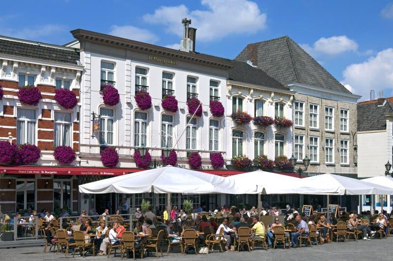 People take terrace at Grote Markt Bergen op Zoom royalty free stock image