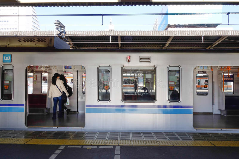 People take a train at station in Tokyo, Japan royalty free stock photo