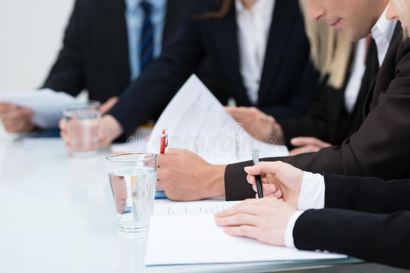 Download People Taking Notes In A Meeting Stock Image - Image of corporate, glass: 33461425