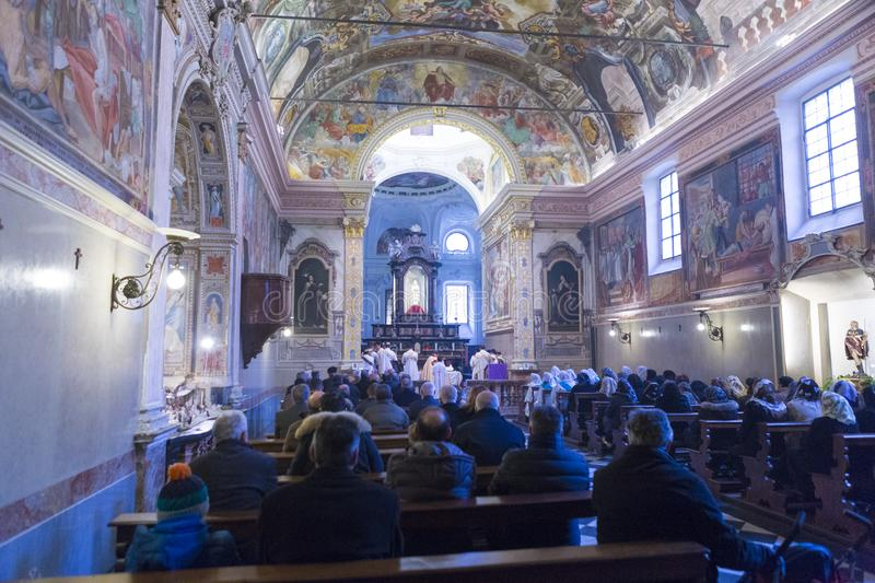 People taking part at the Sunday mass in Chiesa di San Rocco stock image