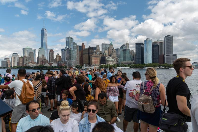 New York City / USA - AUG 22 2018: People taking photo on the fe. People taking photo on the ferry to the Statue of Liberty in clear day in New York City United stock images