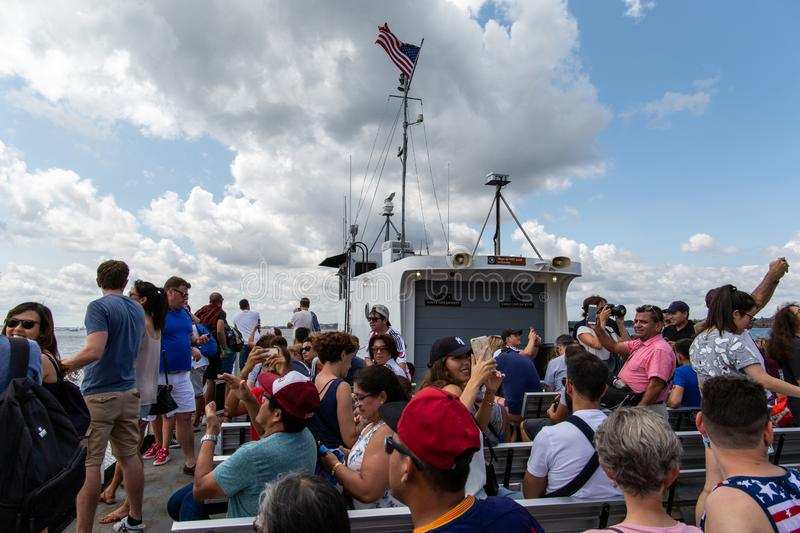 New York City / USA - AUG 22 2018: People taking photo on the fe. People taking photo on the ferry to the Statue of Liberty in clear day in New York City United stock photos