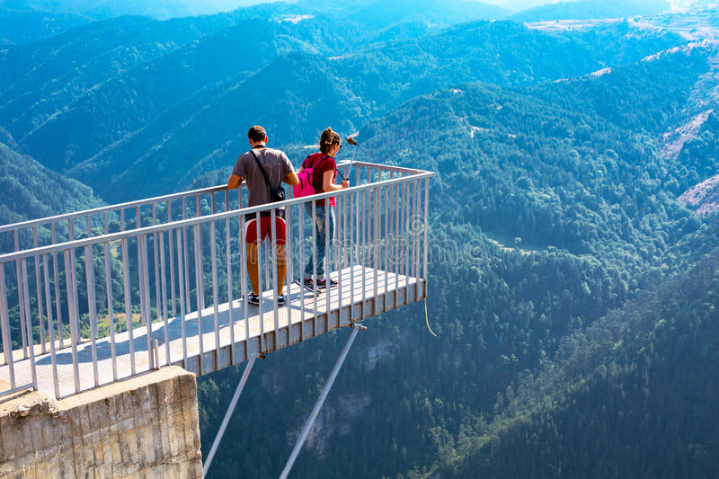 People taking photo at panoramic mountain viewpoint Eagle eye, Orlovo Oko in Rhodope stock photos