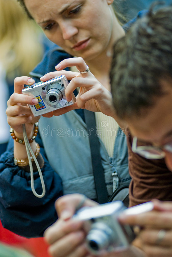 People taking photographs stock photography