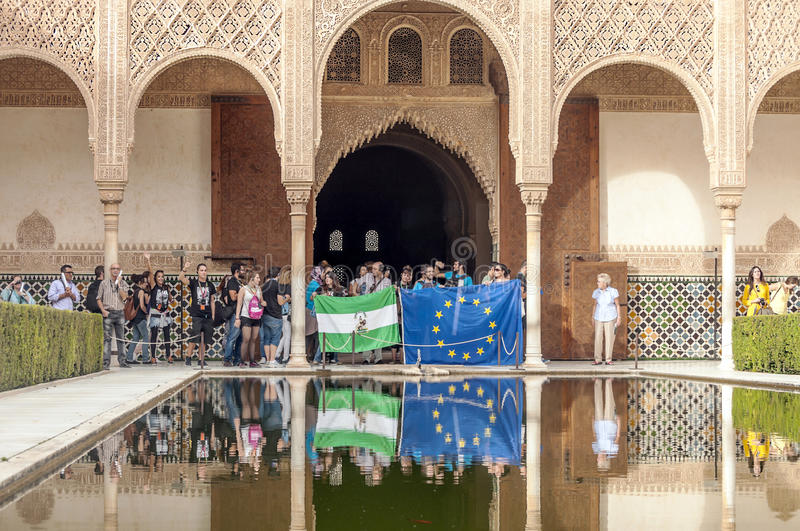 People taking photos in Alhambra. People taking photos in the pond of the Alhambra in Granada, Spain on a sunny day. It is an editorial image taken in October royalty free stock image
