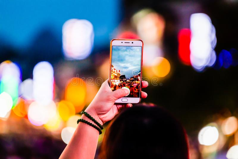 People Taking photos with mobile phone stock photography