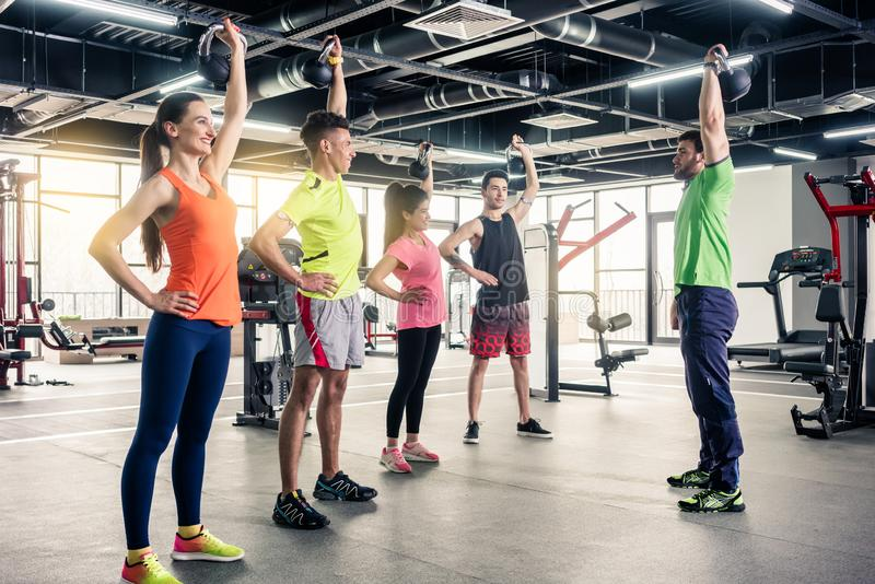People taking training from gym trainer royalty free stock photo