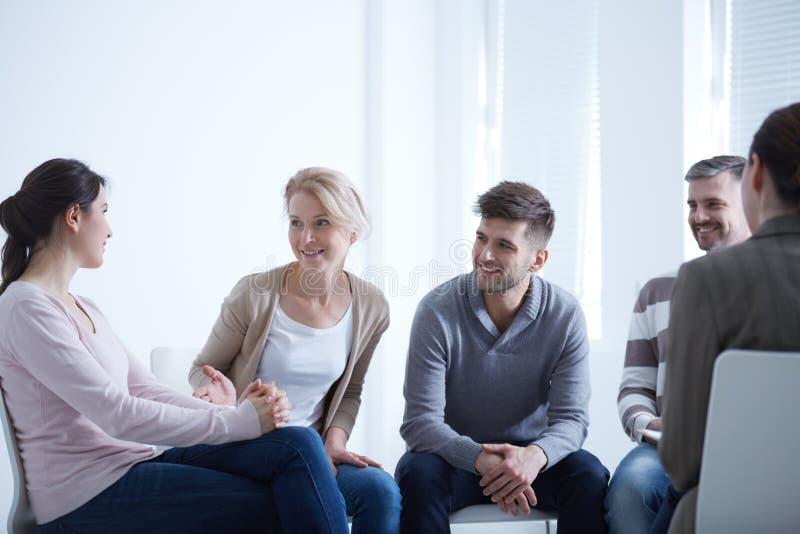 People talking in circle stock image