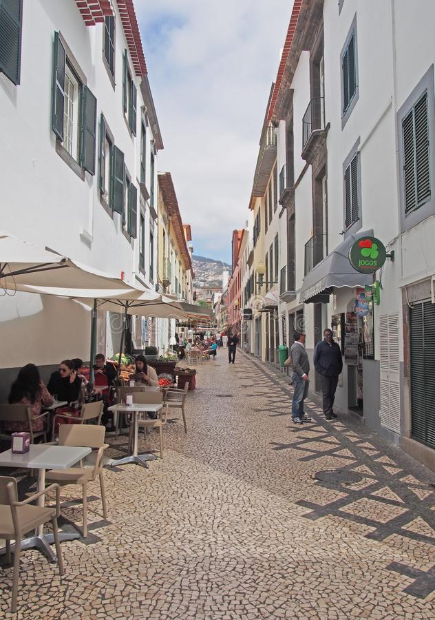 People talking in the street and sitting in cafes a cobbled pedestrian street in the center of Funchal in Madeira stock images