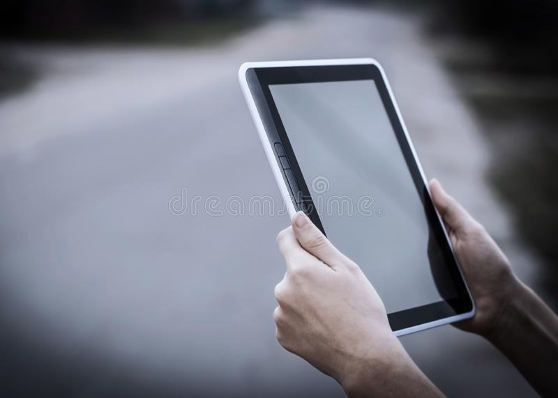 People and technology .closeup of person holding digital tablet royalty free stock photography