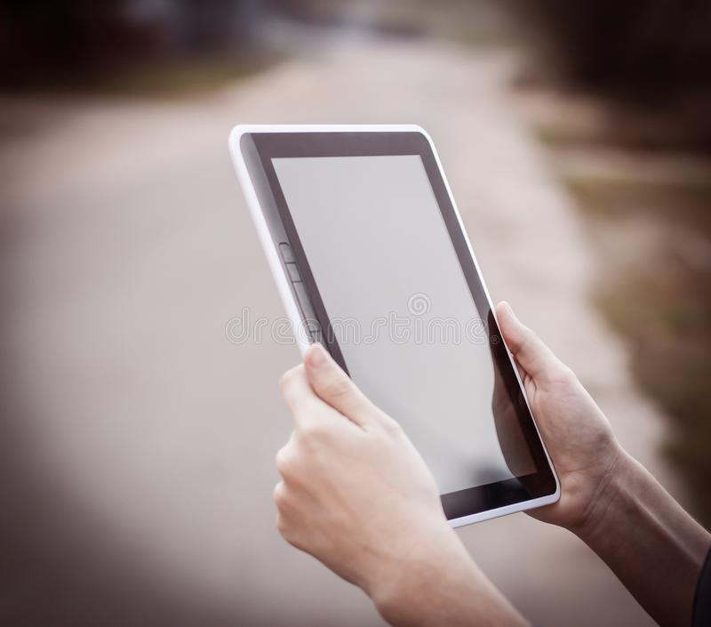 People and technology .closeup of person holding digital tablet royalty free stock image
