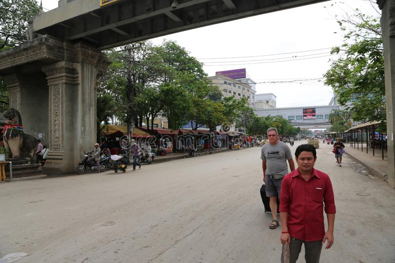 People on Thailand-Cambodia state frontier in Poipet city, Kingdom of Cambodia royalty free stock photo