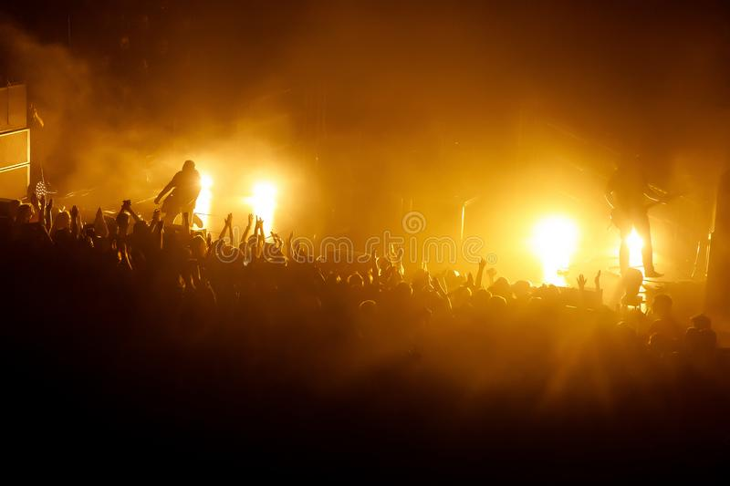 People with their hands up at a concert of their favorite group royalty free stock image