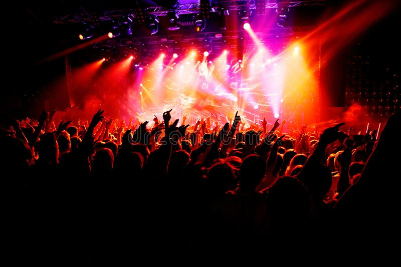 People with their hands up at a concert of their favorite group royalty free stock photo