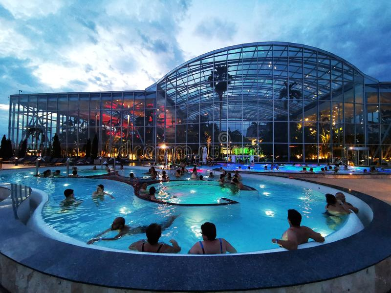 People in thermal pool outdoor at Balotesti, Romania. Therme Bucharest. royalty free stock photo