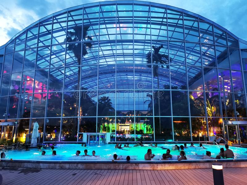 People in thermal pool outdoor at Therme Bucharest, Romania. Palm Zone outdoor stock images