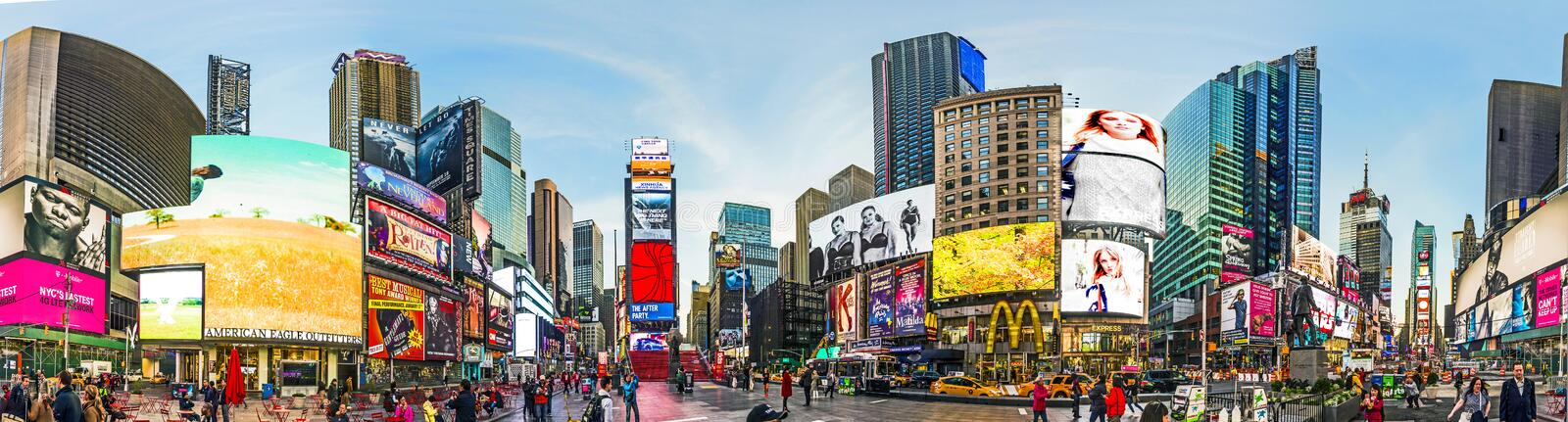 People at Times Square in early morning light. NEW YORK, USA - OCT 21, 2015: people visit Times Square, featured with Broadway Theaters and huge number of LED stock image