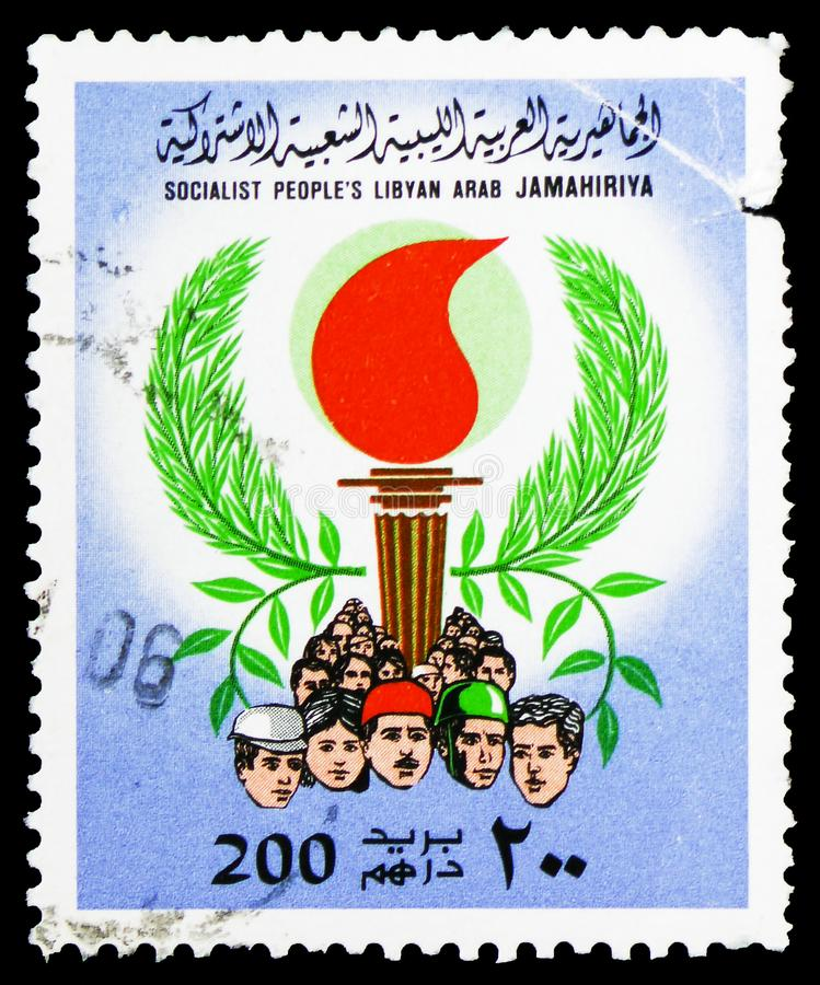People, Torch, Olive Branches, Burning Torch serie, circa 1979. MOSCOW, RUSSIA - FEBRUARY 10, 2019: A stamp printed in Libyan Arab Jamahiriya shows People, Torch stock photos