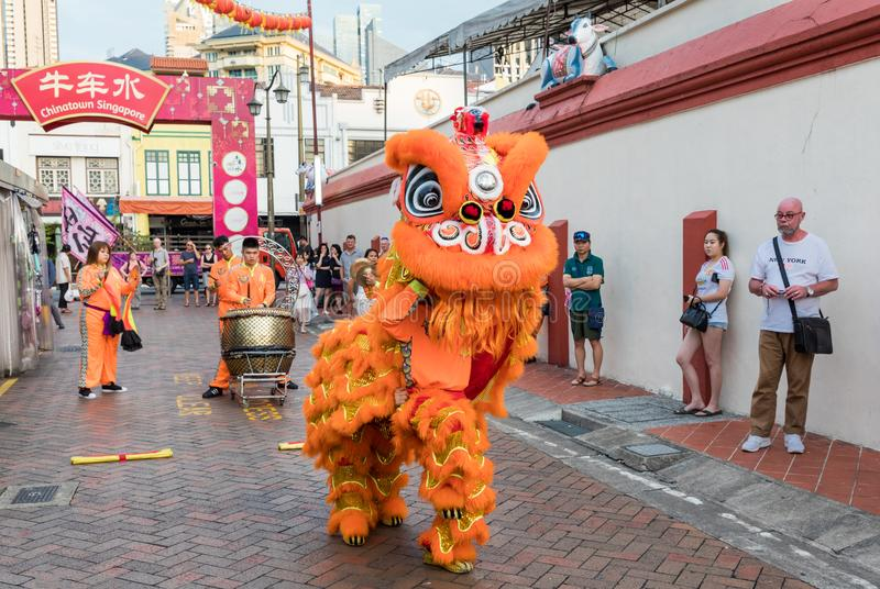 People in traditional costume perform the Chinese lion dance, Chinatown, Singapore stock photo