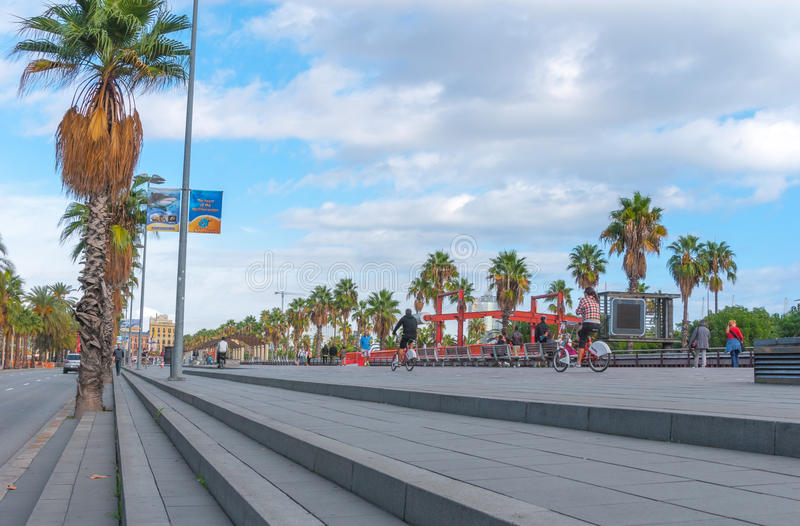 People & traffic, late afternoon in seaside Barcelona, Spain. royalty free stock photos