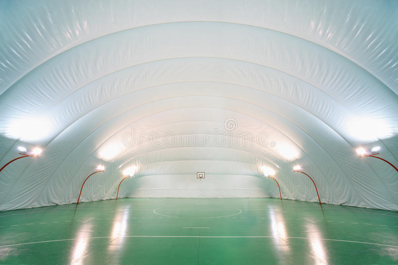 People train in indoor sports ground stock images