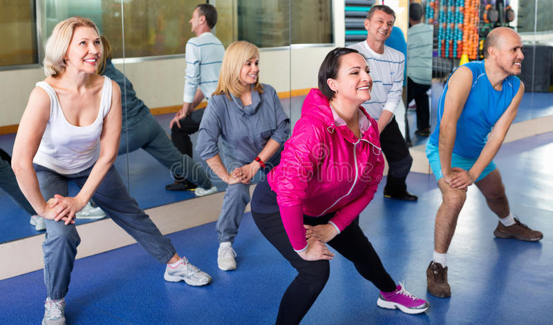 People training in a gym doing pilates royalty free stock photos