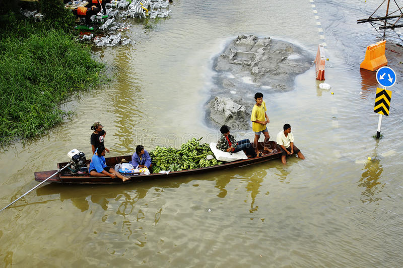 Download People Travel By Boat On The Road During Flood Editorial Stock Photo - Image: 26610603