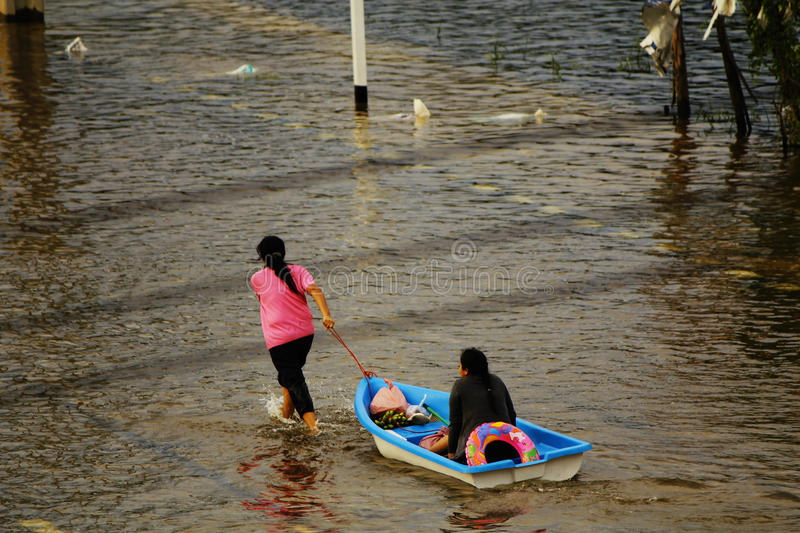 Download People Travel By Boat On The Road During Flood Editorial Photo - Image: 26611126