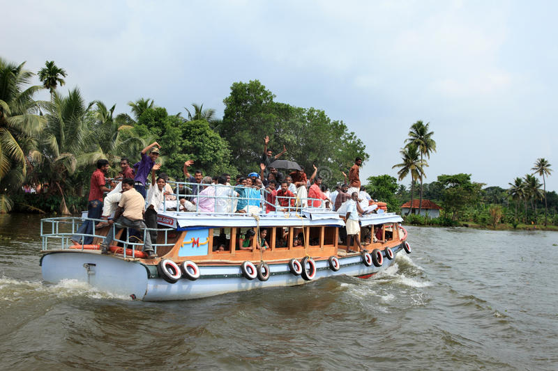 People travel in a small passenger boat in the backwaters. Unidentified people travel in a small passenger boat in the backwaters on May 05, 2011 in Alleppey royalty free stock image