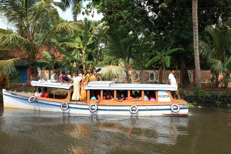 People travel in a small passenger boat in the backwaters. Unidentified people travel in a small passenger boat in the backwaters on May 05, 2011 in Alleppey royalty free stock photography