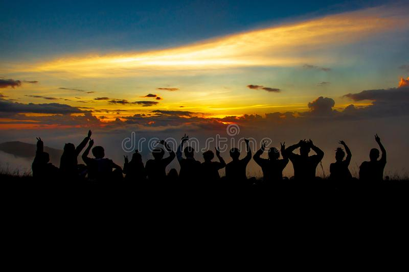 People or traveler sit at cliff and see sunset over the clouds and mountain of forest in silhouette tone at Doi MonJong of Chiangm royalty free stock photography