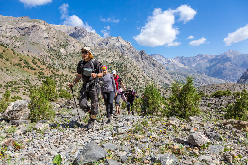 People traveling in mountains royalty free stock images