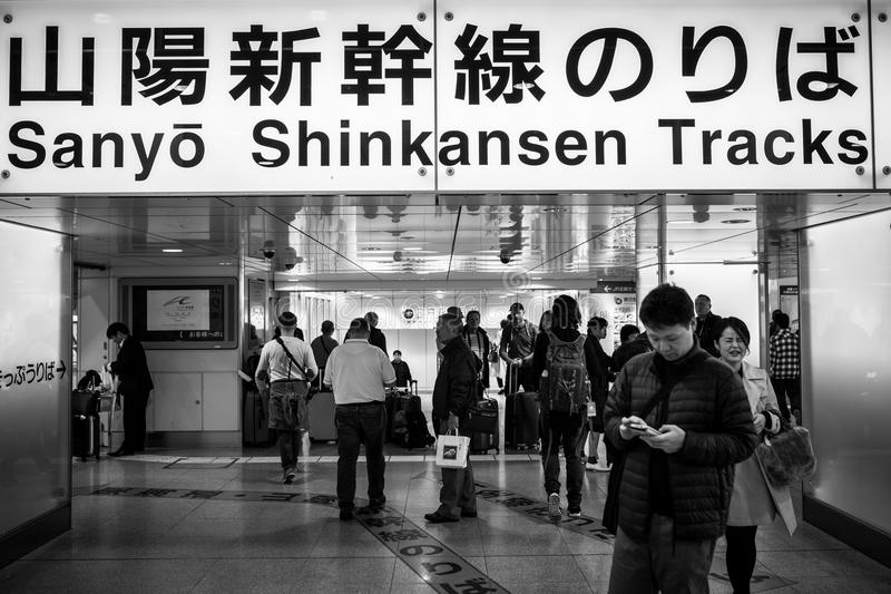 People traveling by Shinkansen tracks in Tokyo, Japan royalty free stock photo