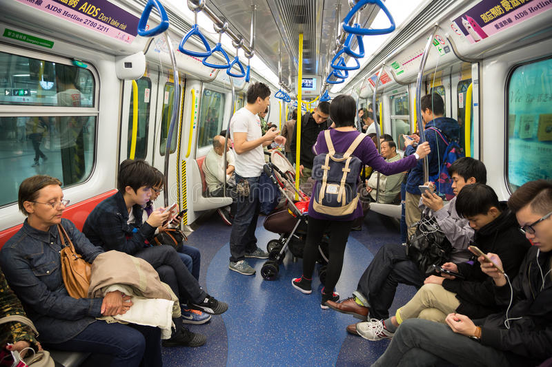 People traveling in the subway in hong kong editorial for Smartphone da hong kong