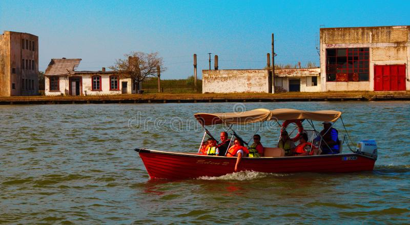 People travelling on the Danube with a boat. Tulcean, life. stock photo