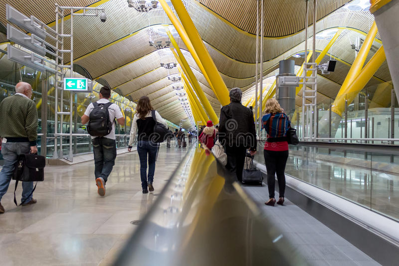 People in a travolator at Barajas airport, Madrid.